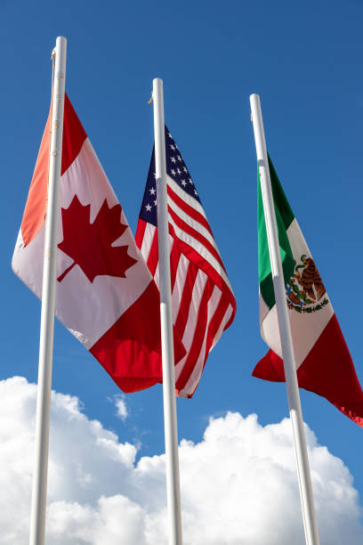 Flags of United States, Mexico, Canada fluttering in the sky stock photo