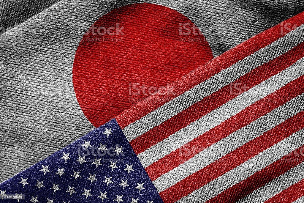 Bandeiras dos EUA e do Japão em textura Grunge - foto de acervo