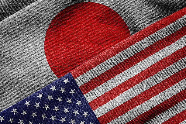 Flags of USA and Japan on Grunge Texture 3D rendering of the flags of USA and Japan on woven fabric texture. Detailed textile pattern and grunge theme. foreign affairs stock pictures, royalty-free photos & images