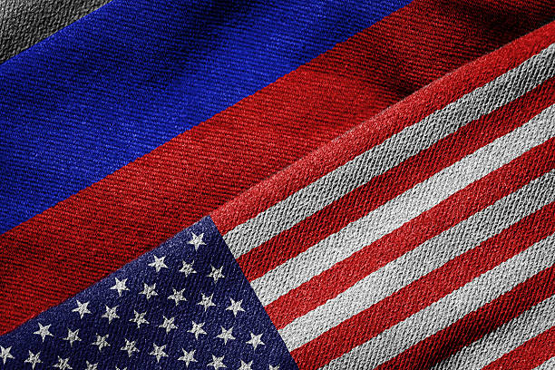 Flags of USA and Russia on Grunge Texture 3D rendering of the flags of USA and Russia on woven fabric texture. Detailed textile pattern and grunge theme. foreign affairs stock pictures, royalty-free photos & images