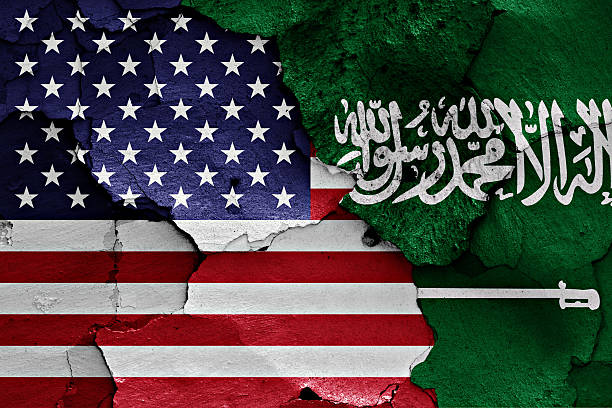flags of usa and saudi arabia painted on cracked wall - saudi national day stok fotoğraflar ve resimler