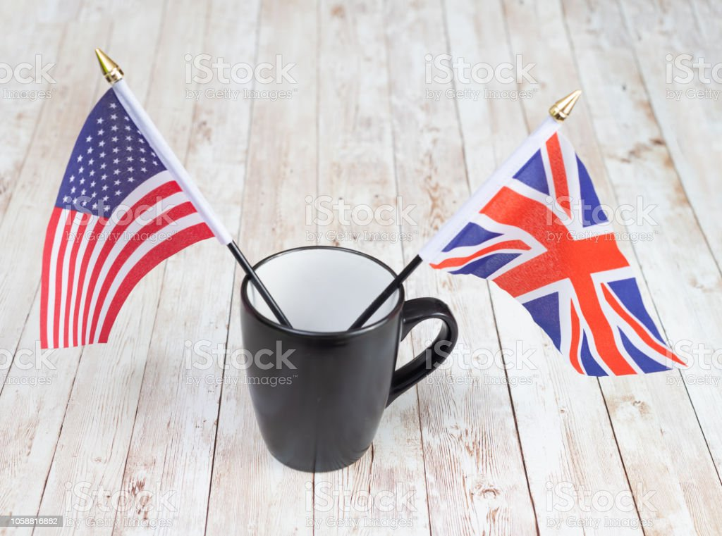 Flags of USA and UK  in a mug stock photo