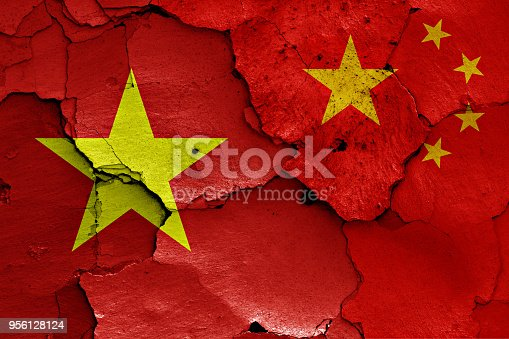 istock flags of Vietnam and China painted on cracked wall 956128124