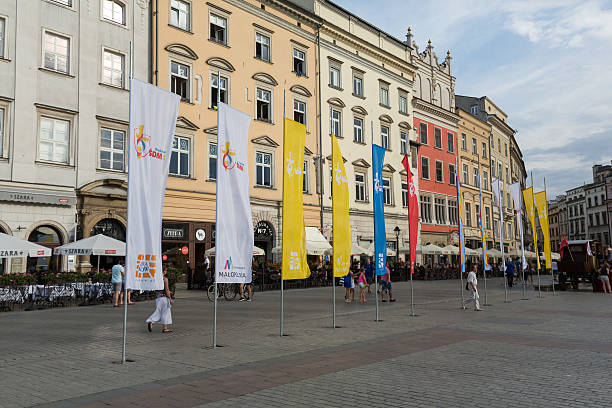 flags of wyd 2016 on main square in cracow - jugendweihe 2016 stock-fotos und bilder