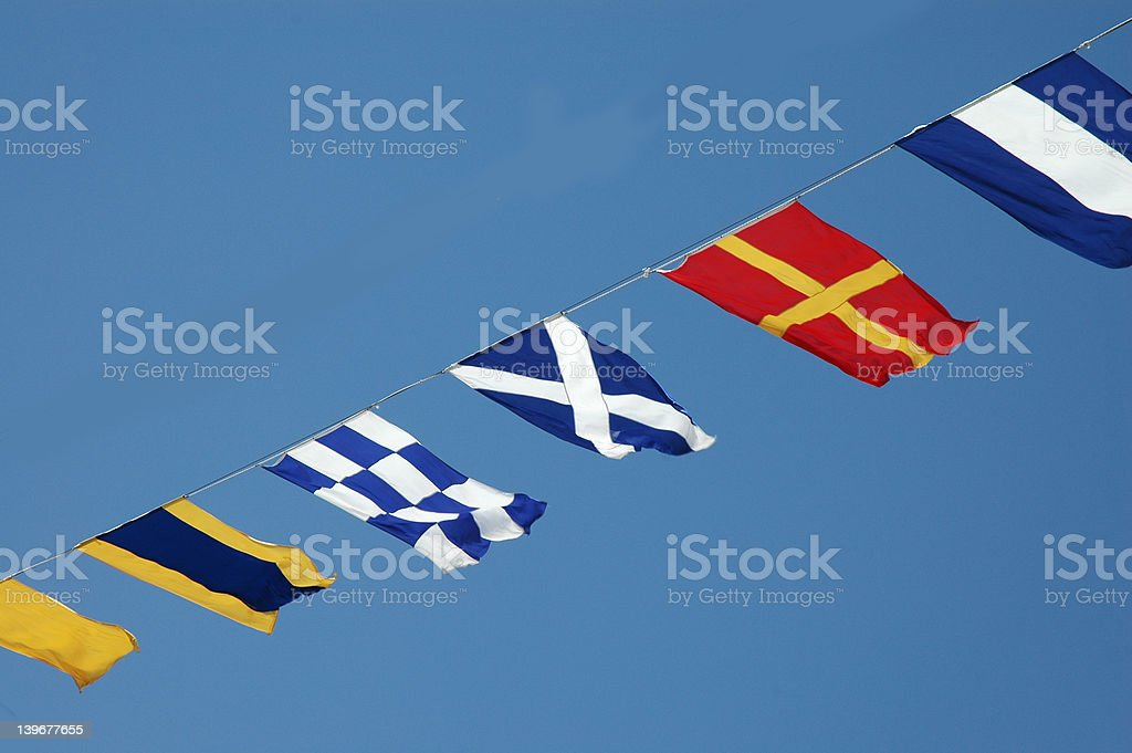 Flags on a ship stock photo