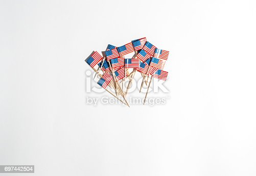 istock US flags on a white background 697442504
