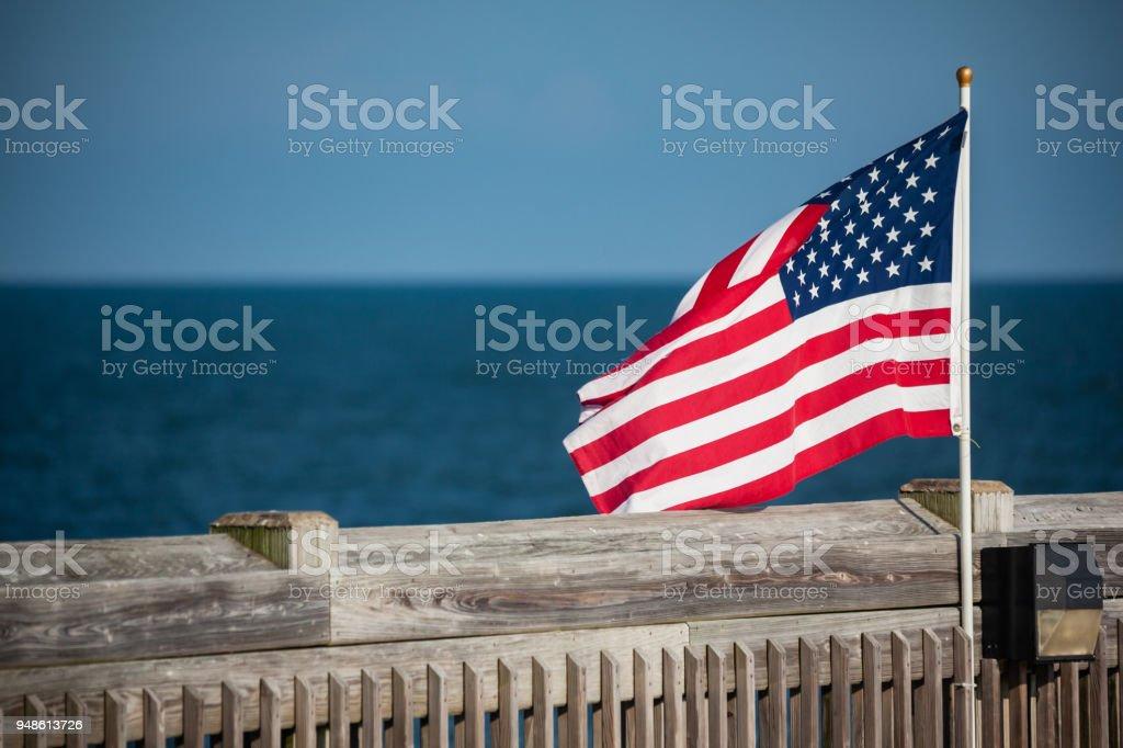 Flags on Charleston, South Carolina Pier stock photo