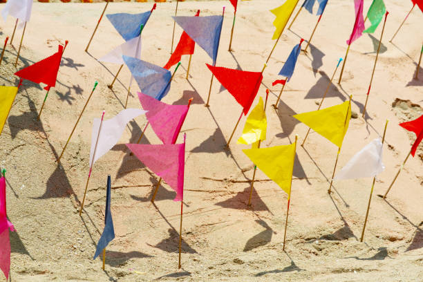 flags on sand pagoda in Songkran festival represents In order to take the sand scraps attached to the feet from the temple to return the temple in the shape of a sand pagoda stock photo