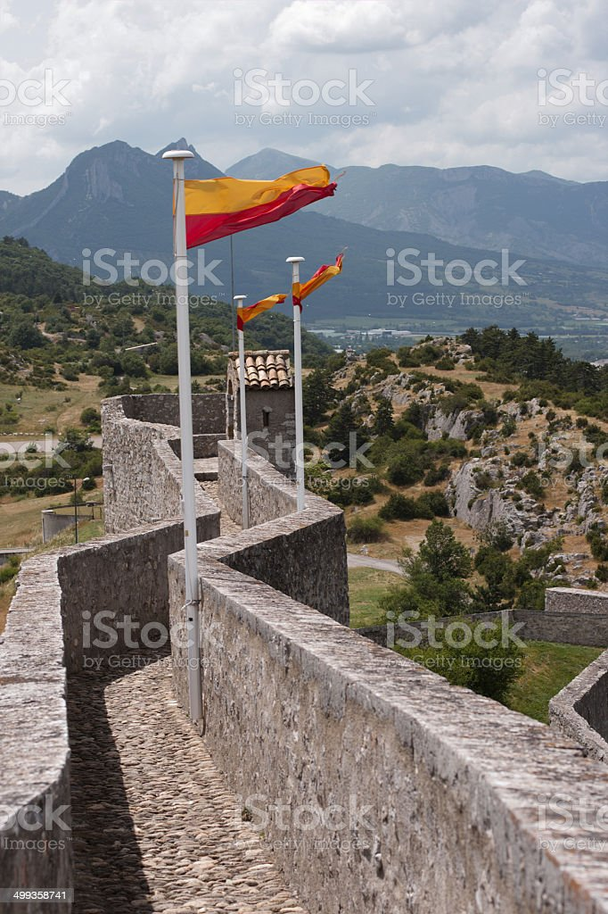 Flags on the wall of citadel. stock photo