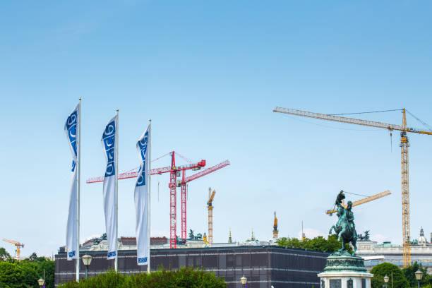 flags osce near the building of hofburg palace - osce congress centre in vienna, austria - vienna congress foto e immagini stock