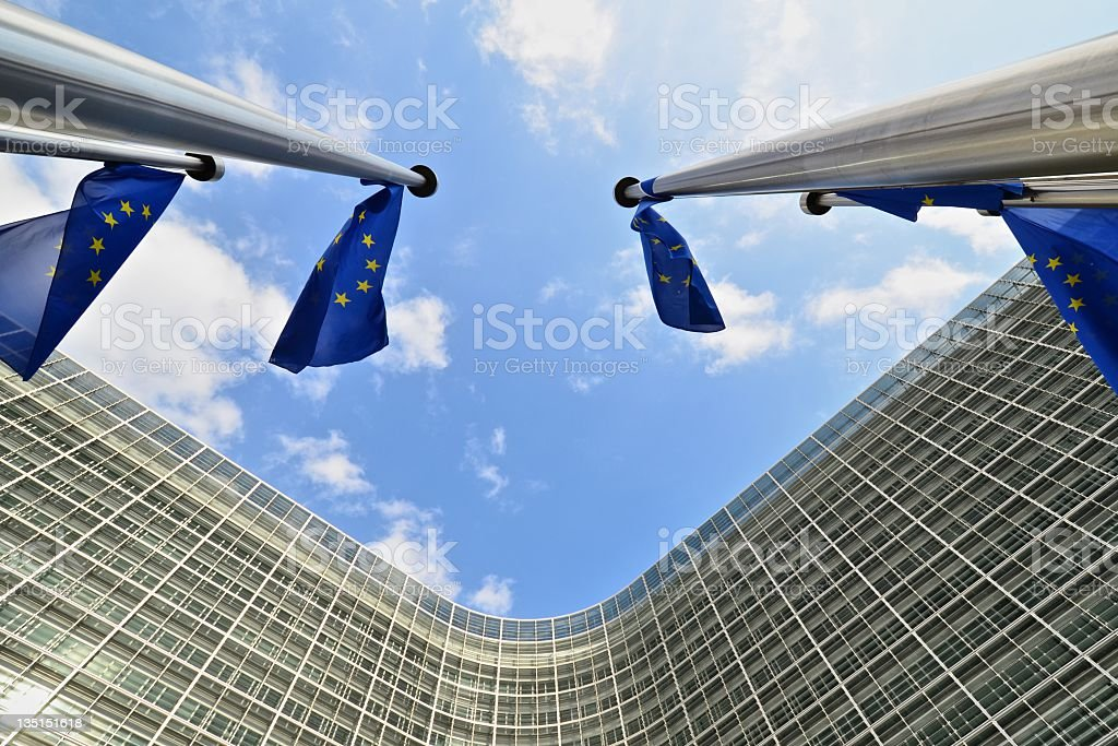 EU flags outside European Commission building in Brussels stock photo
