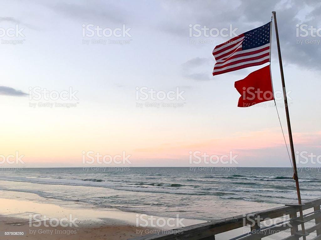 Flags over Atlantic Ocean stock photo