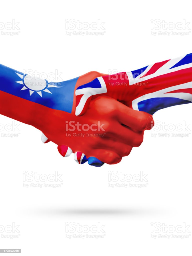 Flags Taiwan, United Kingdom countries, partnership friendship handshake concept. photo libre de droits