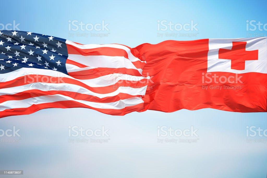 Flags the USA and Tonga stock photo