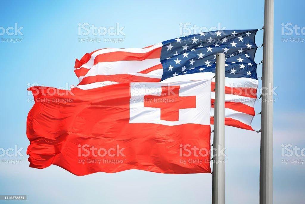 Flags Tonga and the USA stock photo