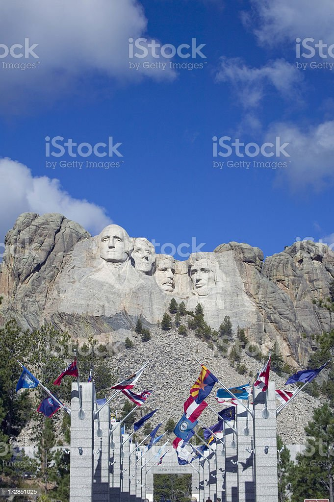 Flags under Mount Rushmore stock photo
