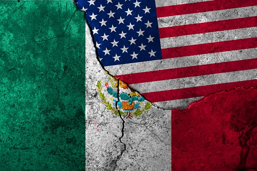 istock Flags: United States, Mexico 957731530