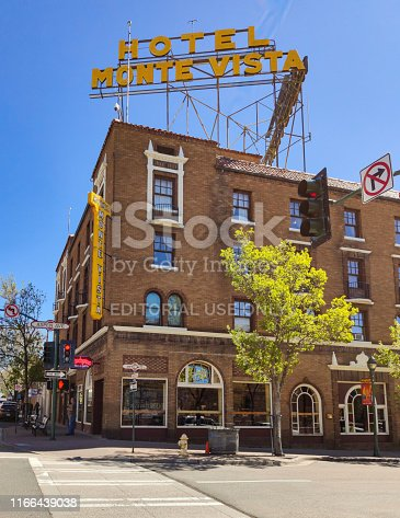 Flagstaff Arizona, USA, May 25 2019. Monte Vista hotel old fashioned building facade with red bricks, clear blue sky background. U.S. Route 66.