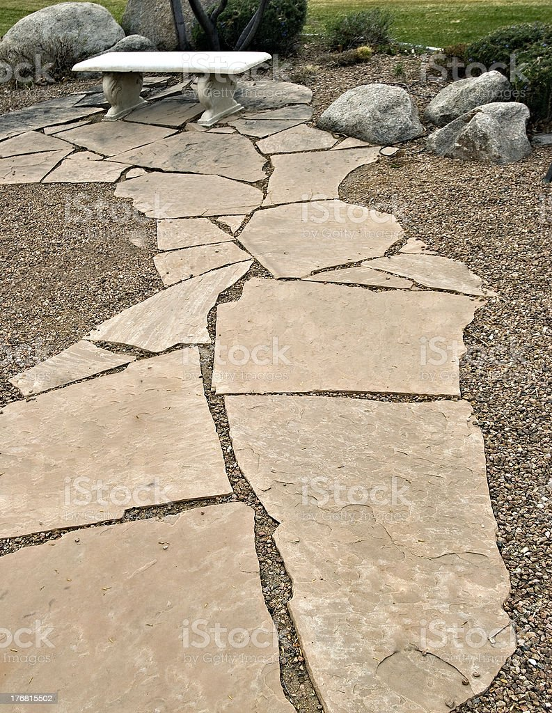 Flagstone Foothpath and Bench in Formal Garden royalty-free stock photo