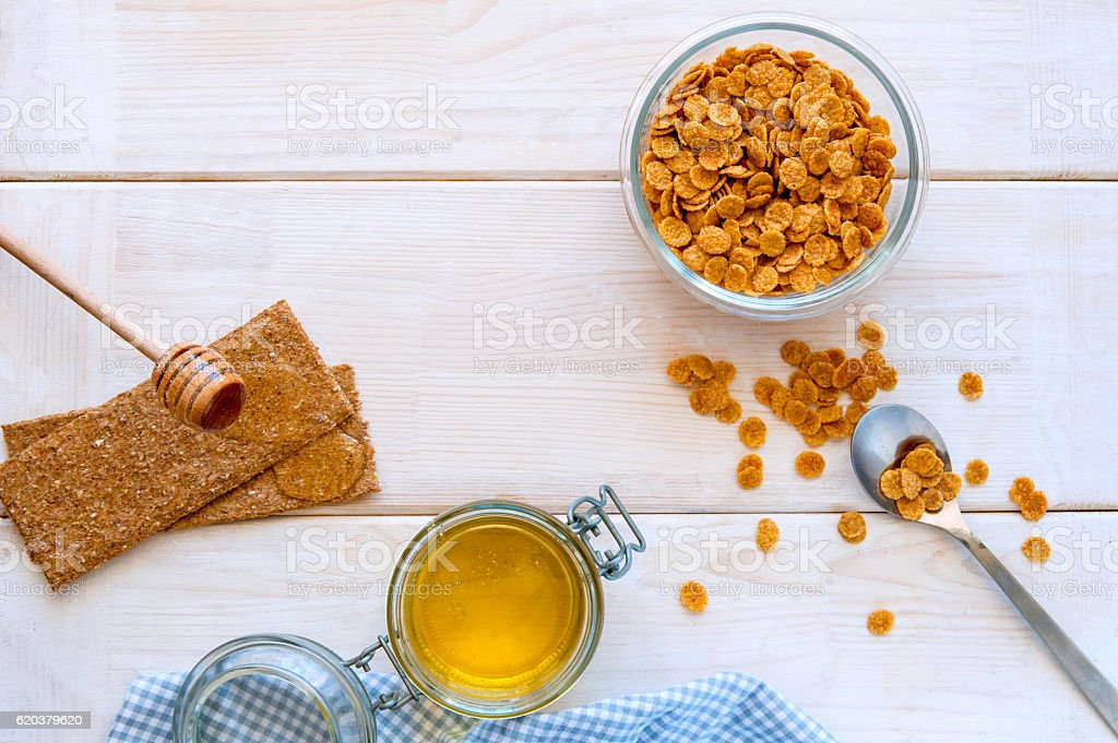 flakes for breakfast with honey on wooden bacgkround top view zbiór zdjęć royalty-free