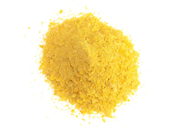 Flakes of Yellow Nutritional Yeast a Cheese Substitute and Seasoning for Vegan Cooking Flakes of Yellow Nutritional Yeast a Cheese Substitute and Seasoning for Vegan Cooking yeast stock pictures, royalty-free photos & images