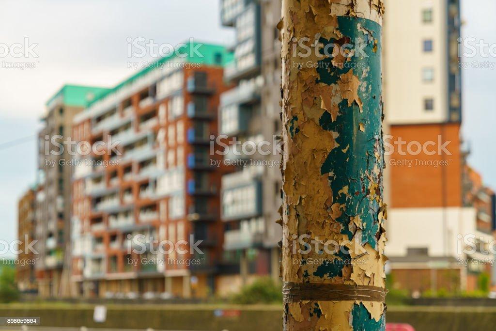 Flaking paint on a street light stock photo
