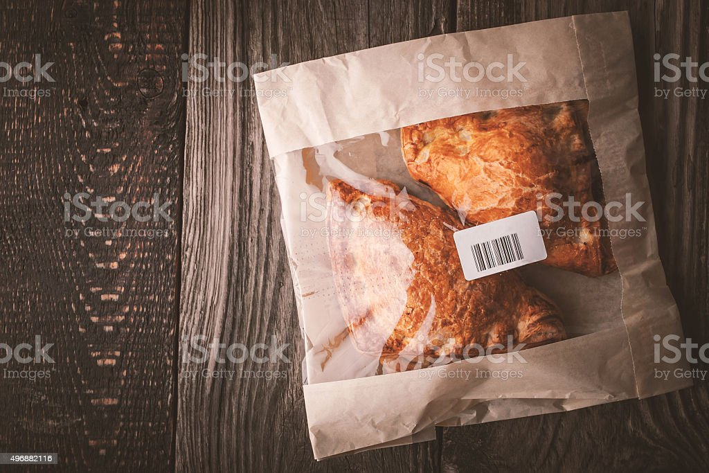 Flaky buns in a package top view stock photo