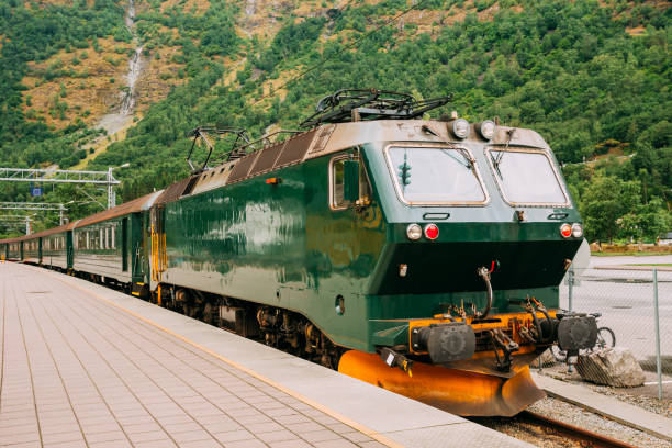Flam, Norway. Famous Railroad Flamsbahn. Green Norwegian Train Near Railway Station Flam, Norway. Famous Railroad Flamsbahn. Green Norwegian Train Near Railway Station. Electric train electric train stock pictures, royalty-free photos & images
