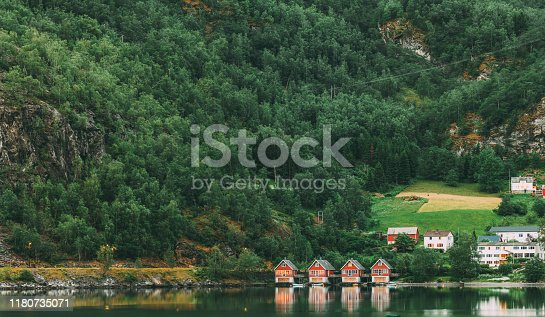 istock Flam, Norway. Famous Red Wooden Docks In Summer Evening. Small Tourist Town Of Flam On Western Side Of Norway Deep In Fjords. Famous Norwegian Landmark And Popular Destination 1180735071