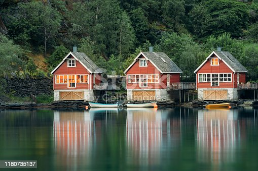istock Flam, Norway. Famous Red Wooden Docks In Summer Evening. Small Tourist Town Of Flam On Western Side Of Norway Deep In Fjords. Famous Norwegian Landmark And Popular Destination 1180735137