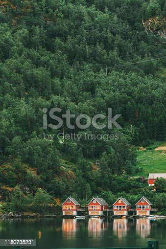 istock Flam, Norway. Famous Red Wooden Docks In Summer Evening. Small Tourist Town Of Flam On Western Side Of Norway Deep In Fjords. Famous Norwegian Landmark And Popular Destination 1180735231