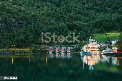 istock Flam, Norway. Famous Red Wooden Docks In Summer Evening. Small Tourist Town Of Flam On Western Side Of Norway Deep In Fjords. Famous Norwegian Landmark And Popular Destination 1180735262