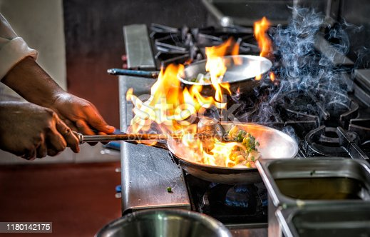 Preparing Indian food by Flame in frying pan