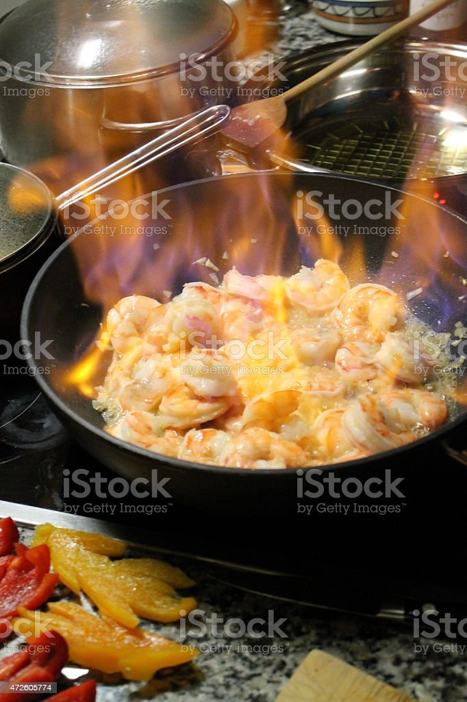 flambéed shrimp stock photo
