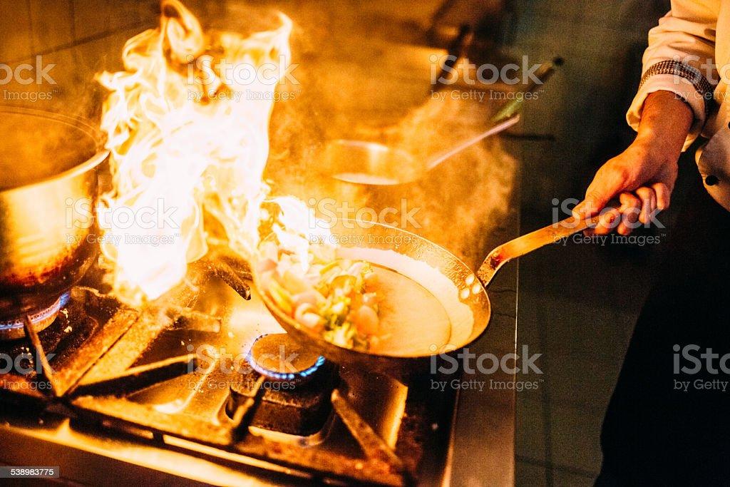Flambing food stock photo