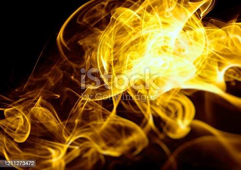 1067101542 istock photo Flame background illuminating the dark 1211273472