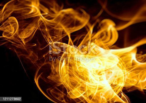 1067101542 istock photo Flame background illuminating the dark 1211273502