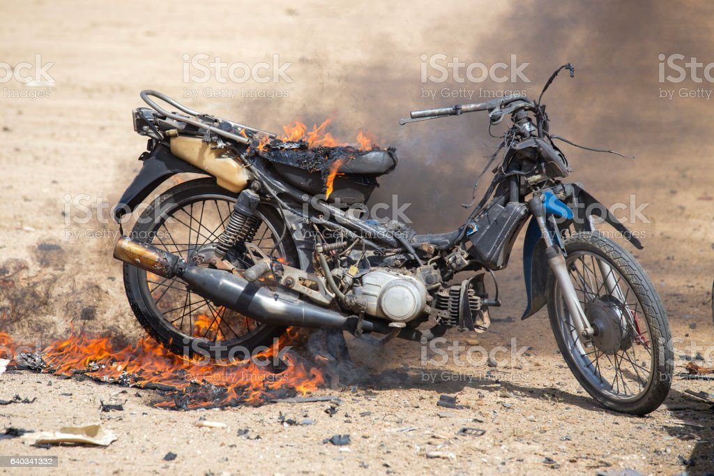 flame burned motorcycle from explosive in forensic training stock photo