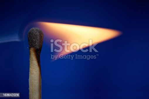 istock Flame from a lit match 163642026