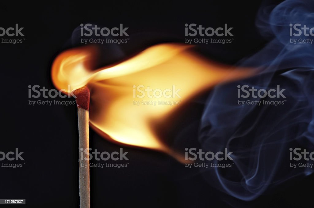 flame from a lit match stock photo