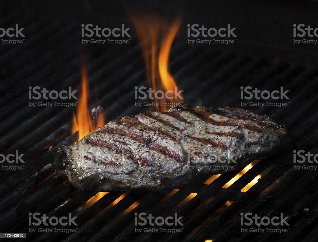 Flame grilled beef rib-eye steak royalty-free stock photo