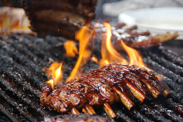 flame grilled spare ribs - ribs stock photos and pictures