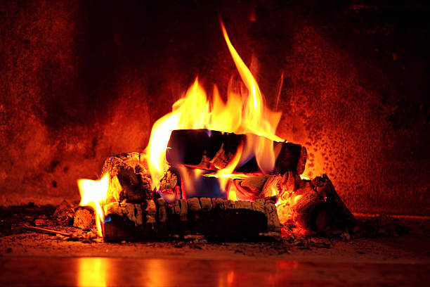 Flame in fireplace. Close up shot of burning firewood in the fireplace. log fire stock pictures, royalty-free photos & images