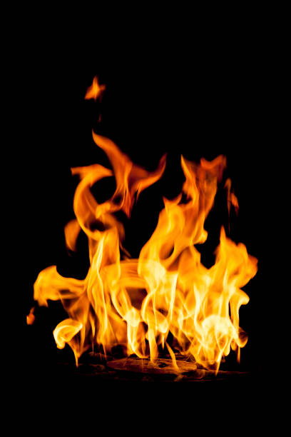 Flame isolated on a black background stock photo