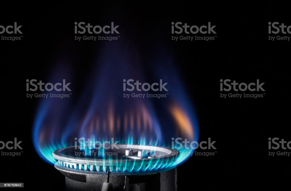 Flame of a gas burner on a black background stock photo