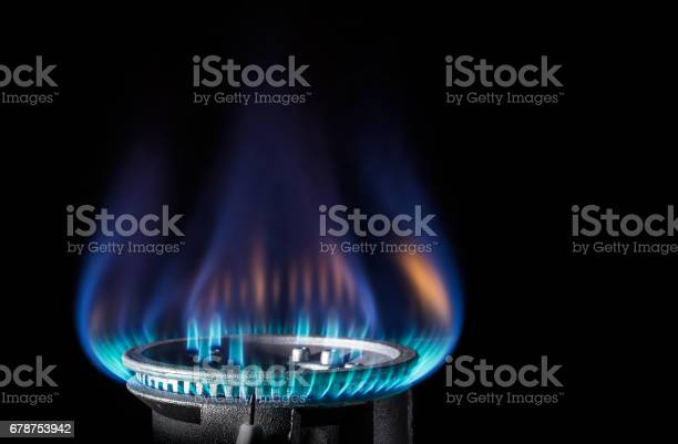Photo of Flame of a gas burner on a black background
