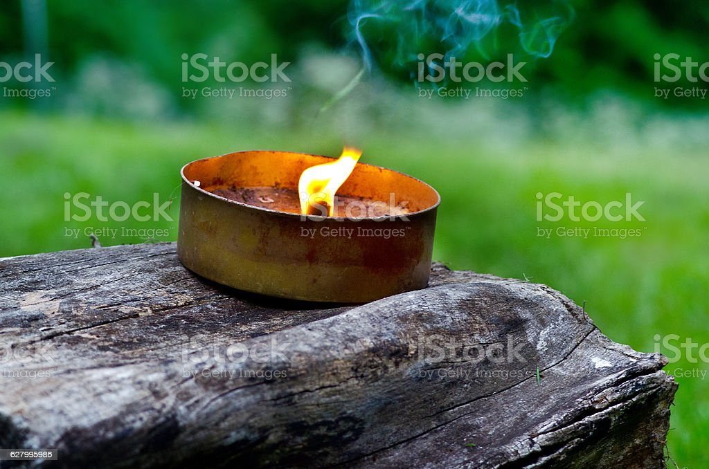 Flame of candle for mosquito stock photo