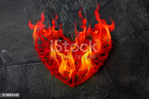 istock Flame of the heart. Real love. The heart is on fire. Theme for Valentine's Day. Wedding, love 916664440