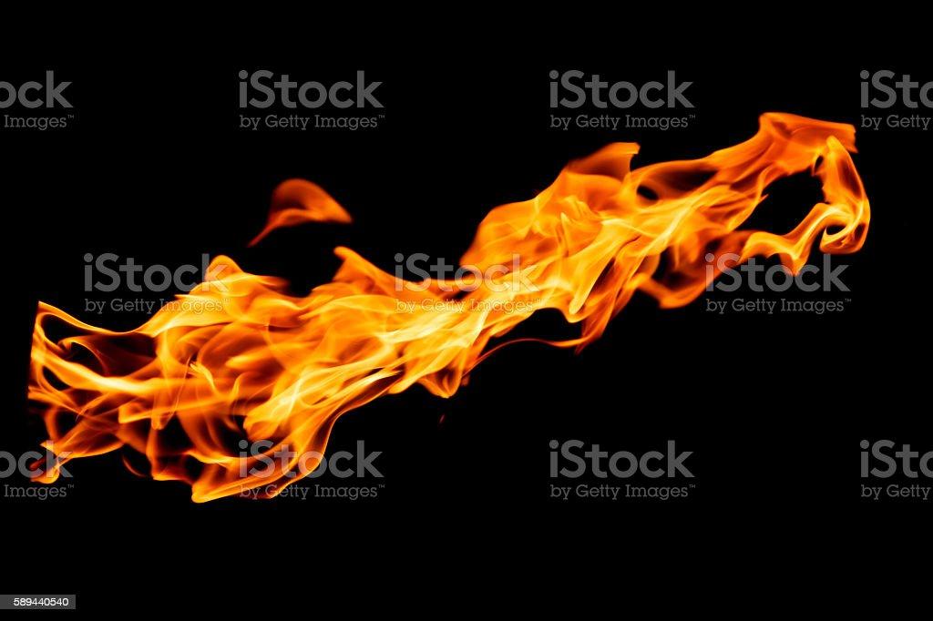 Flame on black background stock photo