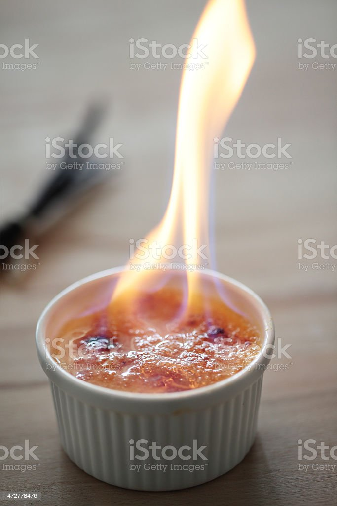 Flame on the creme brulee stock photo